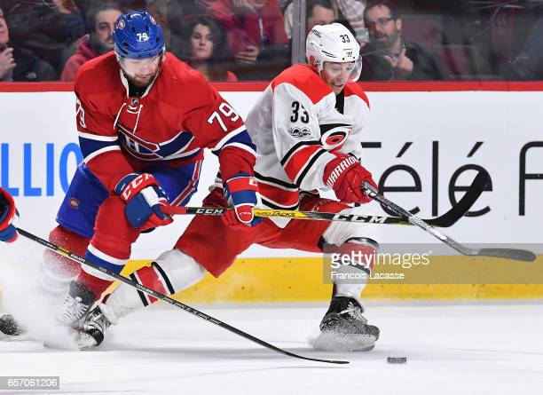 Derek Ryan of the Carolina Hurricanes tries to keep the puck from Andrei Markov of the Montreal Canadiens in the NHL game at the Bell Centre on March...