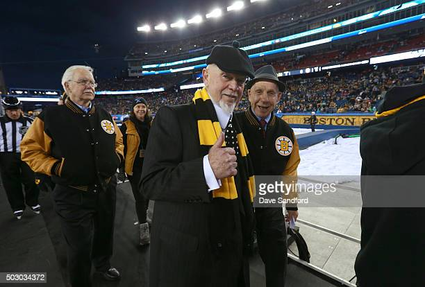 Derek Sanderson Don Cherry and Tom McVie coaches of the Boston Bruins Alumni Team make their way back to the locker room in between periods during...
