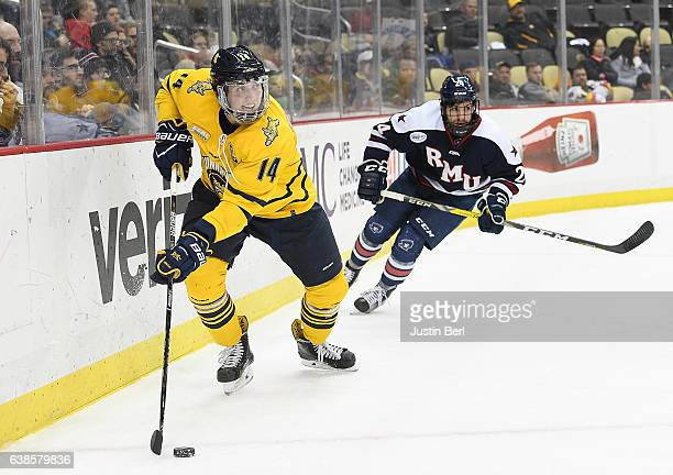 Derek Smith of the Quinnipiac Bobcats controls the puck in the third period during the championship game of the Three Rivers Classic hockey...