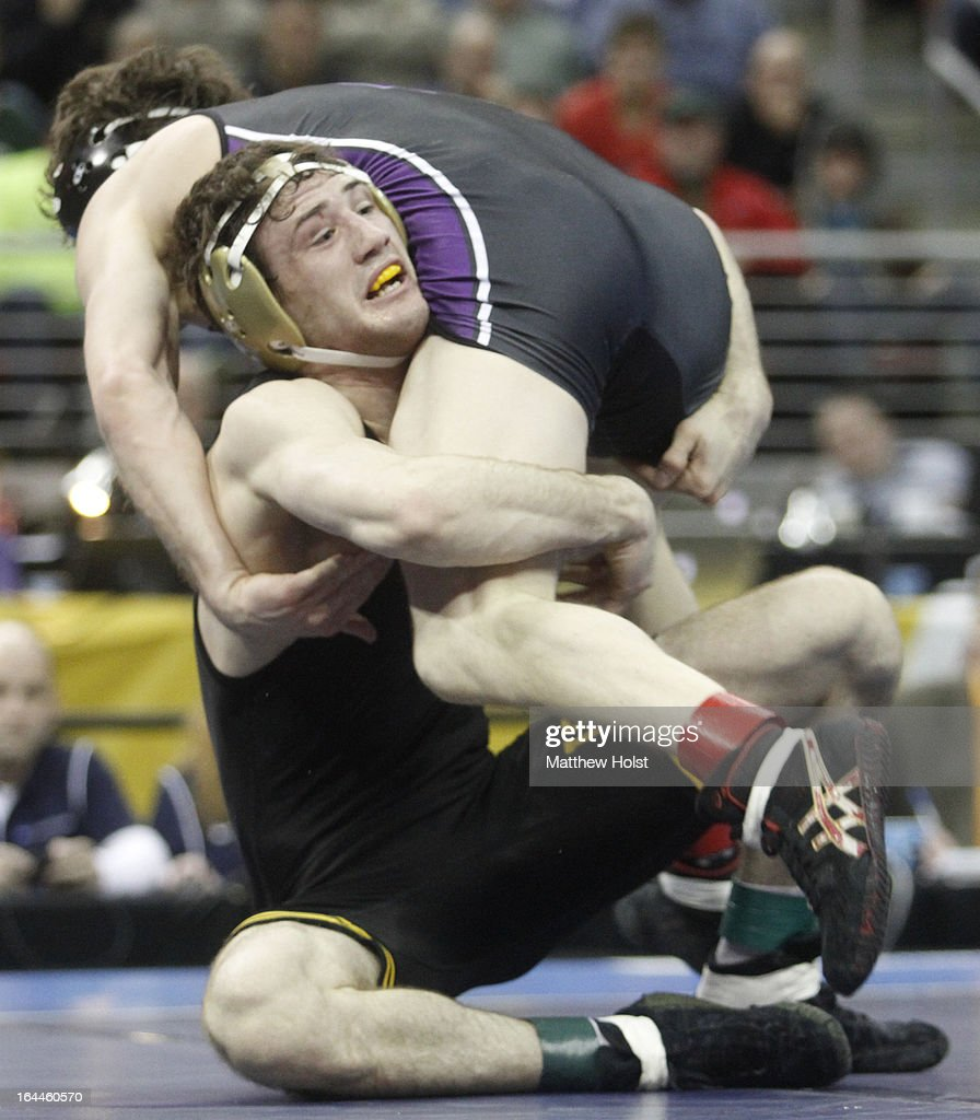 Derek St. John of the Iowa Hawkeyes wrestles Jason Welch of the Northwestern Wildcats in the 157-pound championship match at the 2013 NCAA Wrestling Championships on March 23, 2013 at Wells Fargo Arena in Des Moines, Iowa.