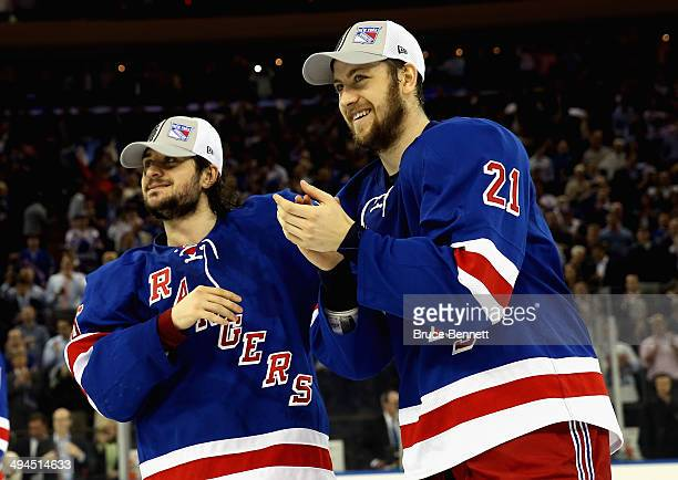 Derek Stepan and Mats Zuccarello of the New York Rangers celebrates after defeating the Montreal Canadiens in Game Six to win the Eastern Conference...