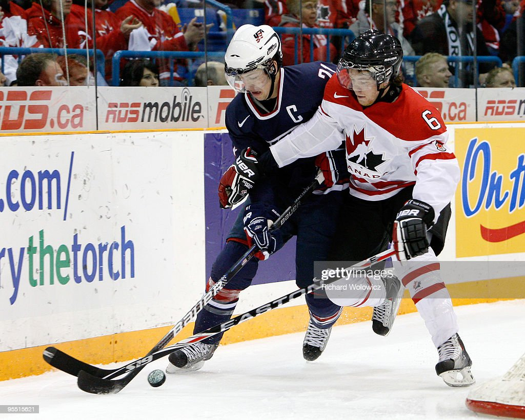 Derek Stepan #21 of Team USA skates with the puck while being defended by Ryan Ellis #6 of Team Canada during the 2010 IIHF World Junior Championship Tournament game on December 31, 2009 at the Credit Union Centre in Saskatoon, Saskatchewan, Canada.