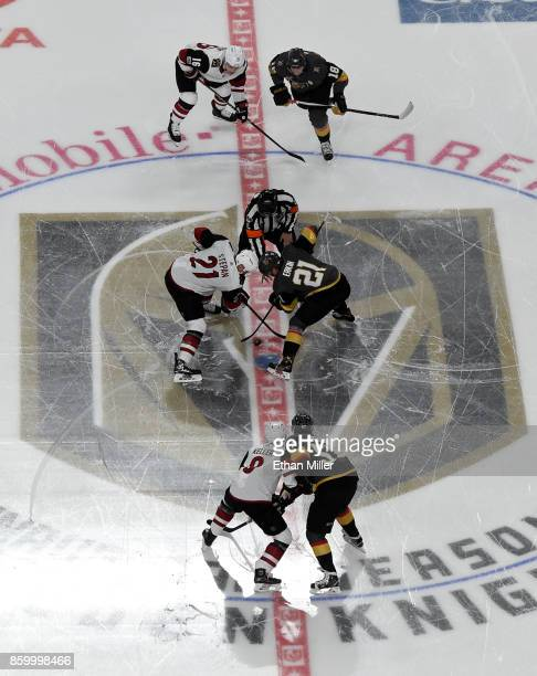 Derek Stepan of the Arizona Coyotes and Cody Eakin of the Vegas Golden Knights take the opening face off at the start of the Golden Knights'...