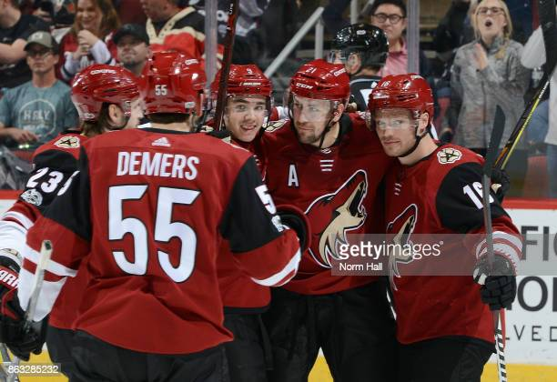 Derek Stepan of the Arizona Coyotes celebrates with teammates Oliver EkmanLarsson Jason Demers Clayton Keller and Max Domi after his second period...