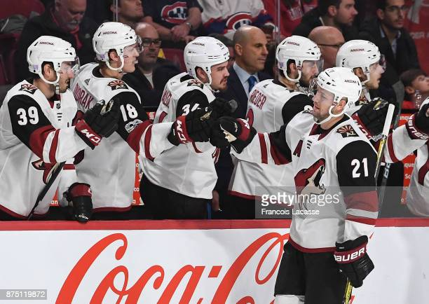 Derek Stepan of the Arizona Coyotes celebrates with the bench after scoring a goal against the Montreal Canadiens in the NHL game at the Bell Centre...
