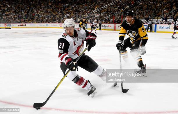 Derek Stepan of the Arizona Coyotes handles the puck against Brian Dumoulin of the Pittsburgh Penguins at PPG Paints Arena on November 7 2017 in...