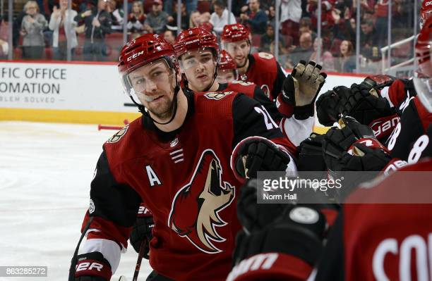 Derek Stepan of the Arizona Coyotes is congratulated by teammates after his second period goal against the Dallas Stars at Gila River Arena on...