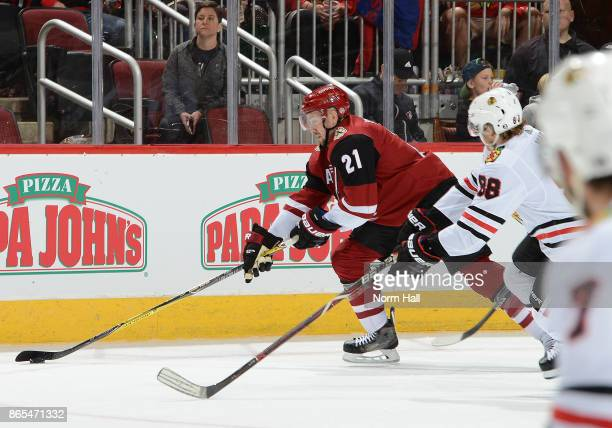 Derek Stepan of the Arizona Coyotes skates with the puck against the Chicago Blackhawks at Gila River Arena on October 21 2017 in Glendale Arizona