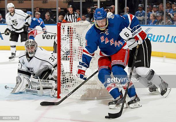 Derek Stepan of the New York Rangers attempts a wraparound on goaltender Jonathan Quick of the Los Angeles Kings during the third period of Game...