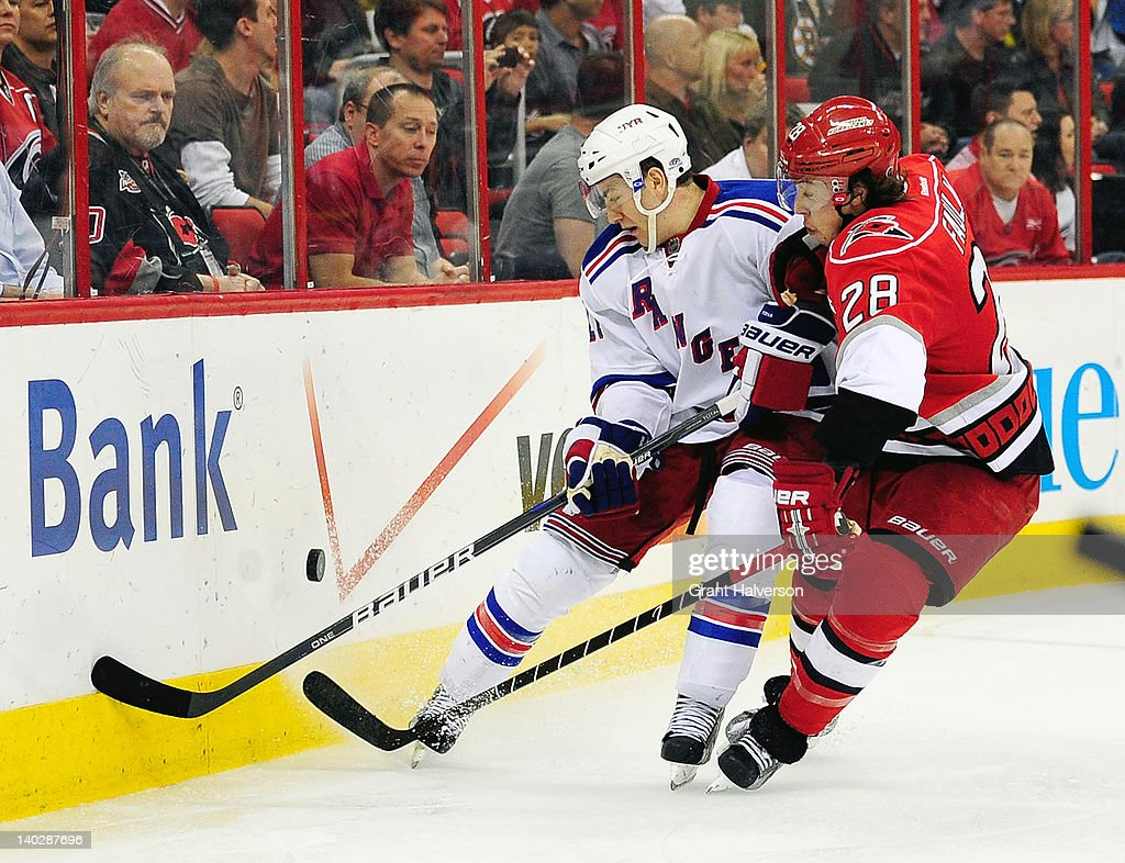 <a gi-track='captionPersonalityLinkClicked' href=/galleries/search?phrase=Derek+Stepan&family=editorial&specificpeople=4687181 ng-click='$event.stopPropagation()'>Derek Stepan</a> #21 of the New York Rangers battles for the puck with Justin Faulk #28 of the Carolina Hurricanes during play at the RBC Center on March 1, 2012 in Raleigh, North Carolina.