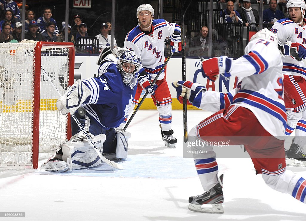 <a gi-track='captionPersonalityLinkClicked' href=/galleries/search?phrase=Derek+Stepan&family=editorial&specificpeople=4687181 ng-click='$event.stopPropagation()'>Derek Stepan</a> #21 of the New York Rangers breaks his stick while shooting as James Reimer #34 of the Toronto Maple Leafs makes a blocker save during NHL game action April 8, 2013 at the Air Canada Centre in Toronto, Ontario, Canada.
