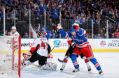 Derek Stepan of the New York Rangers celebrates a goal by Ryan Callahan in the first period against Craig Anderson of the Ottawa Senators in Game One...
