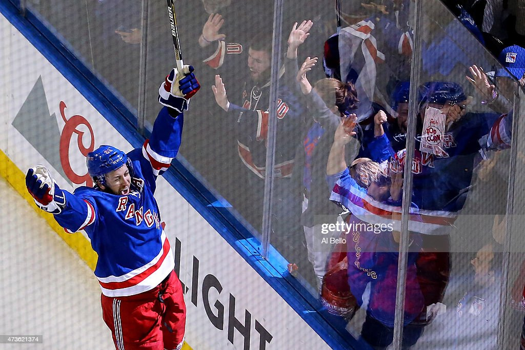 Derek Stepan of the New York Rangers celebrates a second period goal against the Tampa Bay Lightning in Game One of the Eastern Conference Finals...
