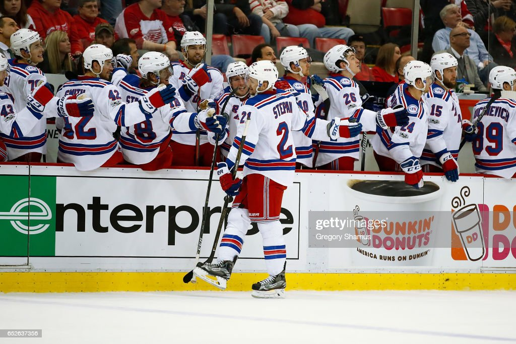 Derek Stepan #21 of the New York Rangers celebrates a third period power play goal with teammates while playing the Detroit Red Wings at Joe Louis Arena on March 12, 2017 in Detroit, Michigan. New York won the game 4-1.