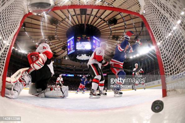 Derek Stepan of the New York Rangers celebrates after Ryan Callahan scored a goal in the first period against goalie Craig Anderson and Kyle Turris...