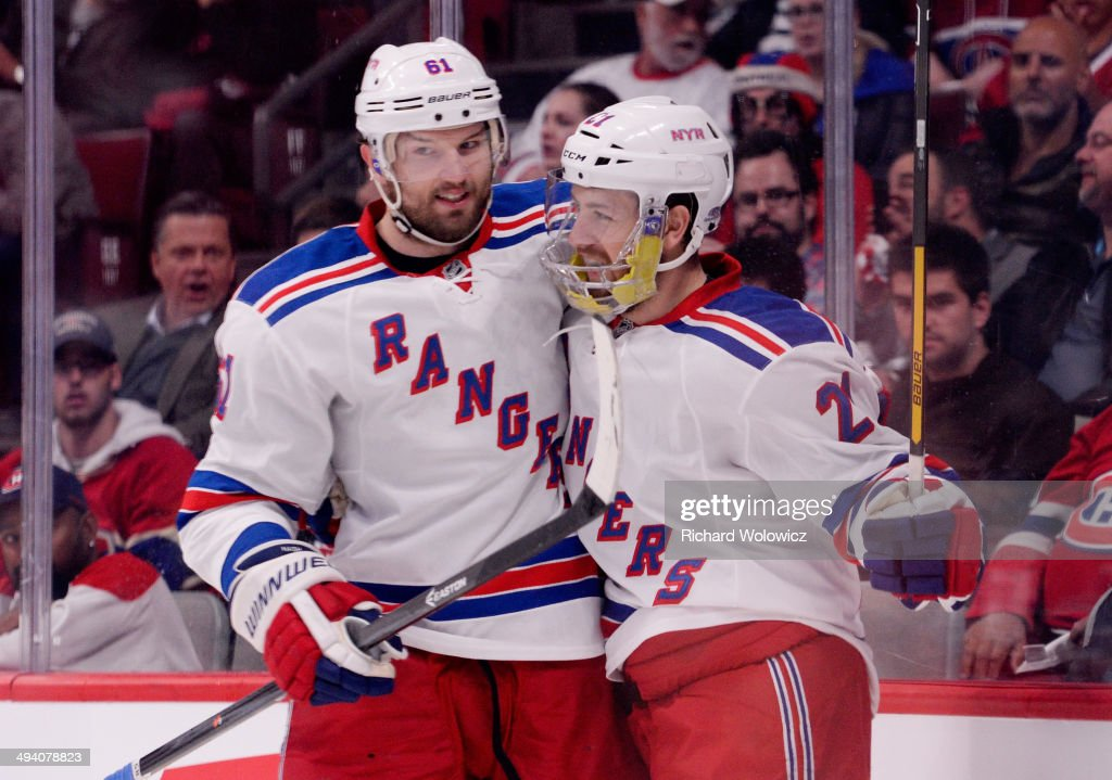 Derek Stepan of the New York Rangers celebrates his first period goal with teammate Rick Nash against the Montreal Canadiens during Game Five of the...