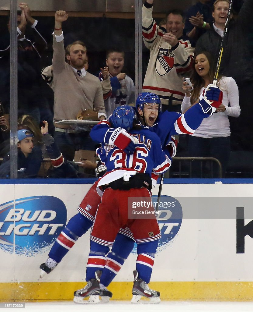 Derek Stepan of the New York Rangers celebrates his goal at 1913 of the first period along with Mats Zuccarello against the Pittsburgh Penguins at...