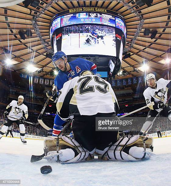 Derek Stepan of the New York Rangers celebrates his powerplay goal at 423 of the first period against MarcAndre Fleury of the Pittsburgh Penguins in...
