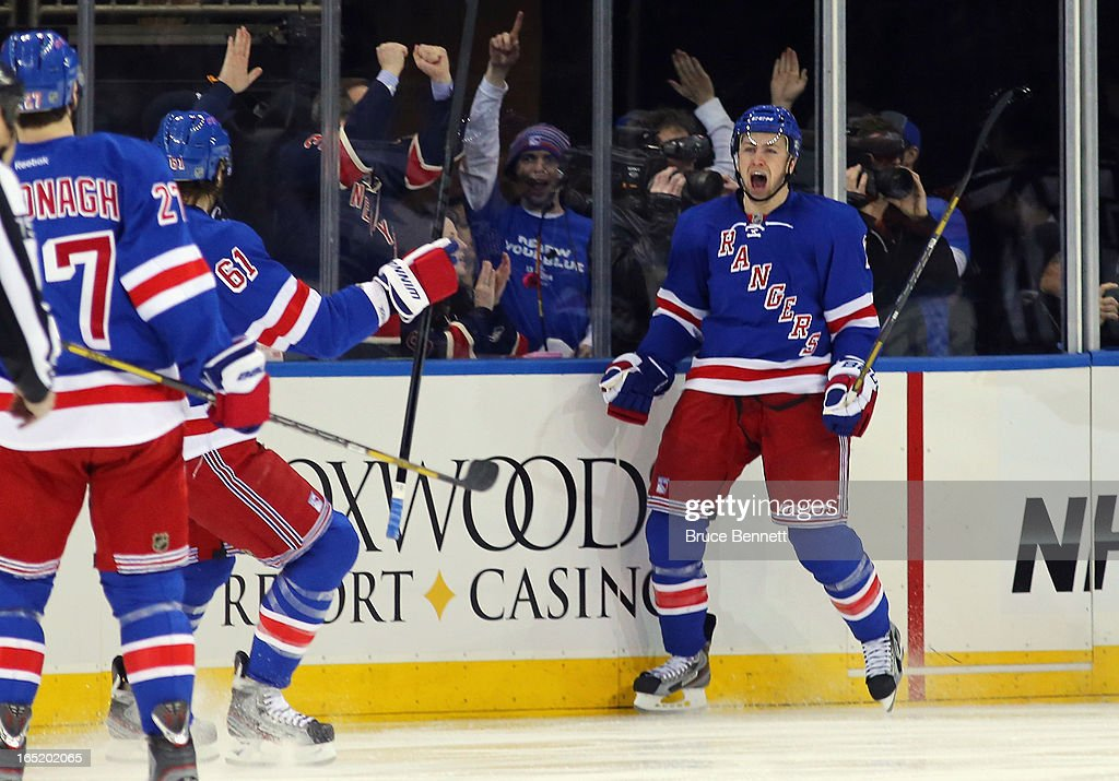 <a gi-track='captionPersonalityLinkClicked' href=/galleries/search?phrase=Derek+Stepan&family=editorial&specificpeople=4687181 ng-click='$event.stopPropagation()'>Derek Stepan</a> #21 of the New York Rangers celebrates his score at 19 seconds of the first period against the Winnipeg Jets at Madison Square Garden on April 1, 2013 in New York City.