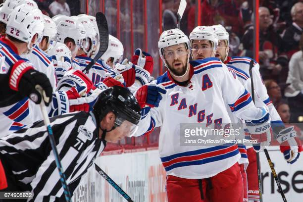 Derek Stepan of the New York Rangers celebrates his second period shorthand goal against the Ottawa Senators with teammates on the bench in Game Two...
