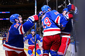 Derek Stepan of the New York Rangers celebrates with Chris Kreider Jesper Fast and his team after scoring the game winning goal in overtime against...