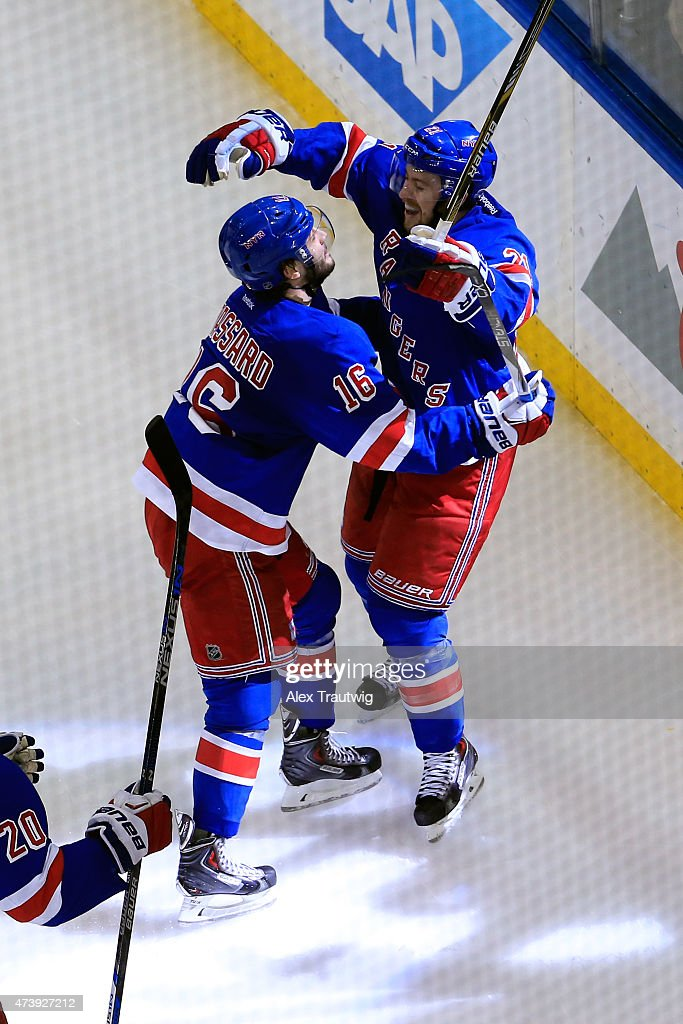 Derek Stepan #21 of the New York Rangers celebrates with his teammates after scoring a goal in the second period against Ben Bishop #30 of the Tampa Bay Lightning during Game Two of the Eastern Conference Finals during the 2015 NHL Stanley Cup Playoffs at Madison Square Garden on May 18, 2015 in New York City.