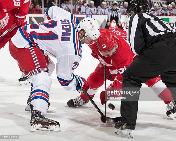 Derek Stepan of the New York Rangers faces off against Frans Nielsen of the Detroit Red Wings during an NHL game at Joe Louis Arena on January 22...