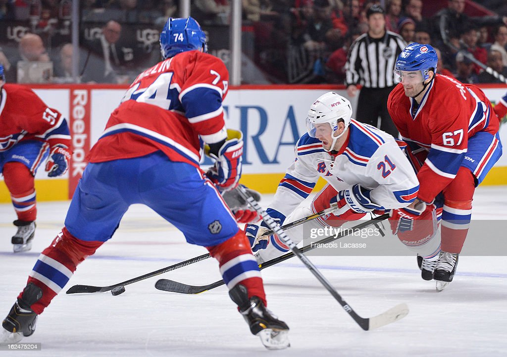 <a gi-track='captionPersonalityLinkClicked' href=/galleries/search?phrase=Derek+Stepan&family=editorial&specificpeople=4687181 ng-click='$event.stopPropagation()'>Derek Stepan</a> #21 of the New York Rangers falls to the ice after being checked by <a gi-track='captionPersonalityLinkClicked' href=/galleries/search?phrase=Max+Pacioretty&family=editorial&specificpeople=4324972 ng-click='$event.stopPropagation()'>Max Pacioretty</a> #67 of the Montreal Canadiens during the NHL game on February 23, 2013 at the Bell Centre in Montreal, Quebec, Canada.