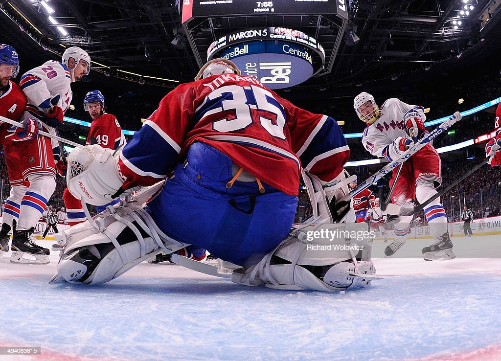 Derek Stepan of the New York Rangers fires the puck past Dustin Tokarski of the Montreal Canadiens for a second period goal at 1206 during Game Five...