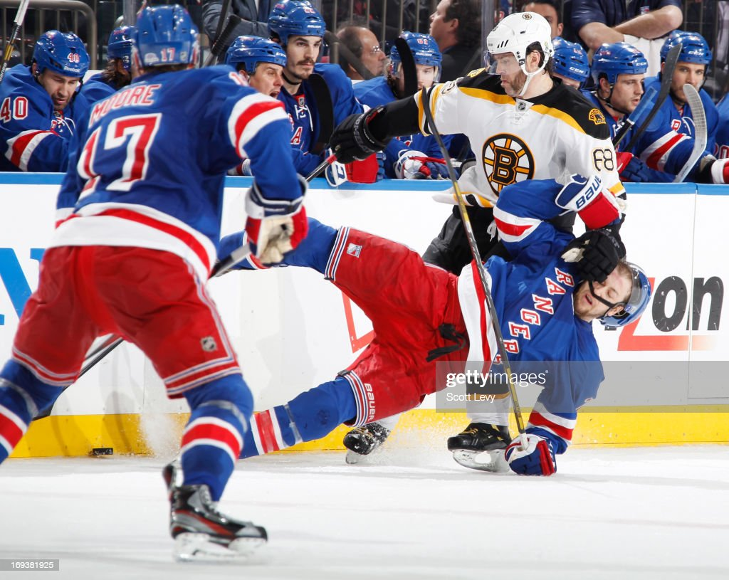 Derek Stepan of the New York Rangers gets thrown to the ice by Jaromir Jagr of the Boston Bruins in Game Four of the Eastern Conference Semifinals...