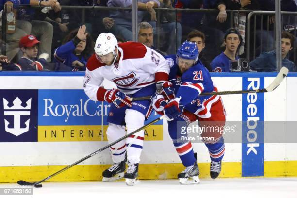 Derek Stepan of the New York Rangers holds Alex Galchenyuk of the Montreal Canadiens during the first period in Game Six of the Eastern Conference...