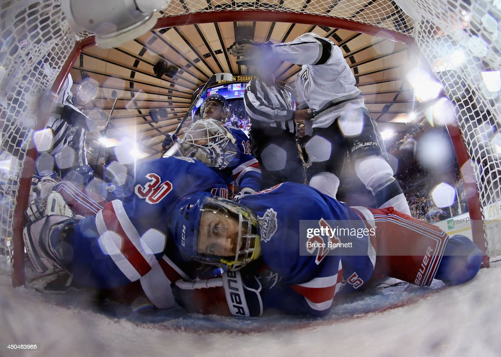 Derek Stepan of the New York Rangers lies on the ice after clearing the puck from the goal line behind Henrik Lundqvist of the New York Rangers...