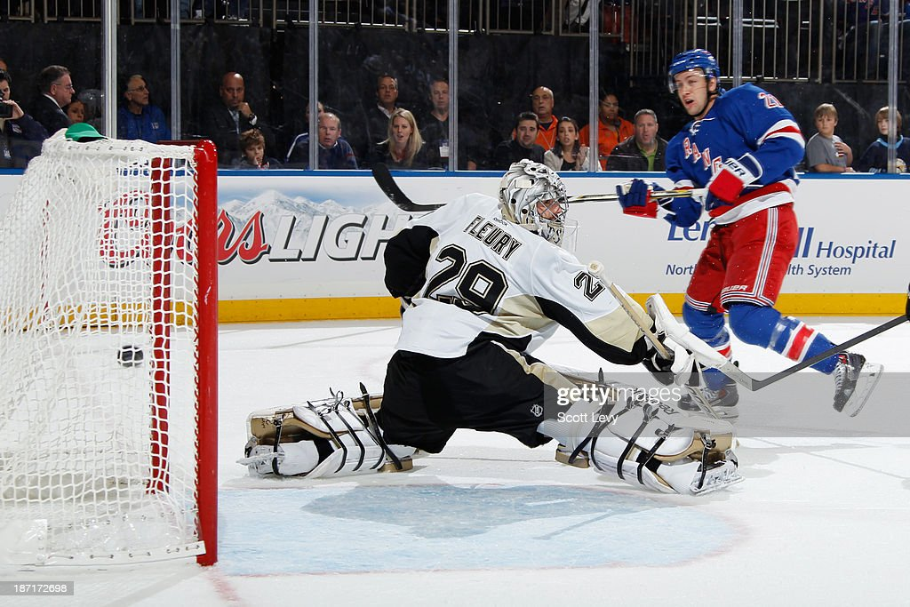 Derek Stepan of the New York Rangers puts the puck past MarcAndre Fleury of the Pittsburgh Penguins for a goal in the first period at Madison Square...