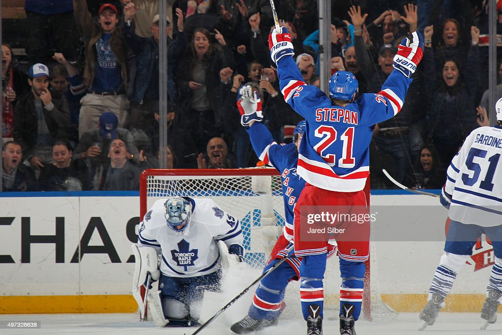 Derek Stepan #21 of the New York Rangers reacts after scoring a goal against Jonathan Bernier #45 of the Toronto Maple Leafs from center ice in the second period at Madison Square Garden on November 15, 2015 in New York City.