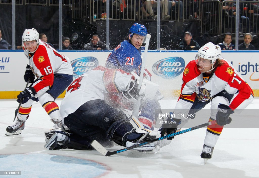 <a gi-track='captionPersonalityLinkClicked' href=/galleries/search?phrase=Derek+Stepan&family=editorial&specificpeople=4687181 ng-click='$event.stopPropagation()'>Derek Stepan</a> #21 of the New York Rangers runs into Tim Thomas #34 of the Florida Panthers at Madison Square Garden on November 10, 2013 in New York City.