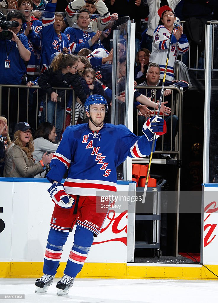 <a gi-track='captionPersonalityLinkClicked' href=/galleries/search?phrase=Derek+Stepan&family=editorial&specificpeople=4687181 ng-click='$event.stopPropagation()'>Derek Stepan</a> #21 of the New York Rangers salutes fans as the number two star of the game against the Winnipeg Jets at Madison Square Garden on April 1, 2013 in New York City. The Rangers defeat the Jets 4-2.