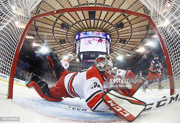 Derek Stepan of the New York Rangers scores at 405 of the first period against Michael Leighton of the Carolina Hurricanes at Madison Square Garden...