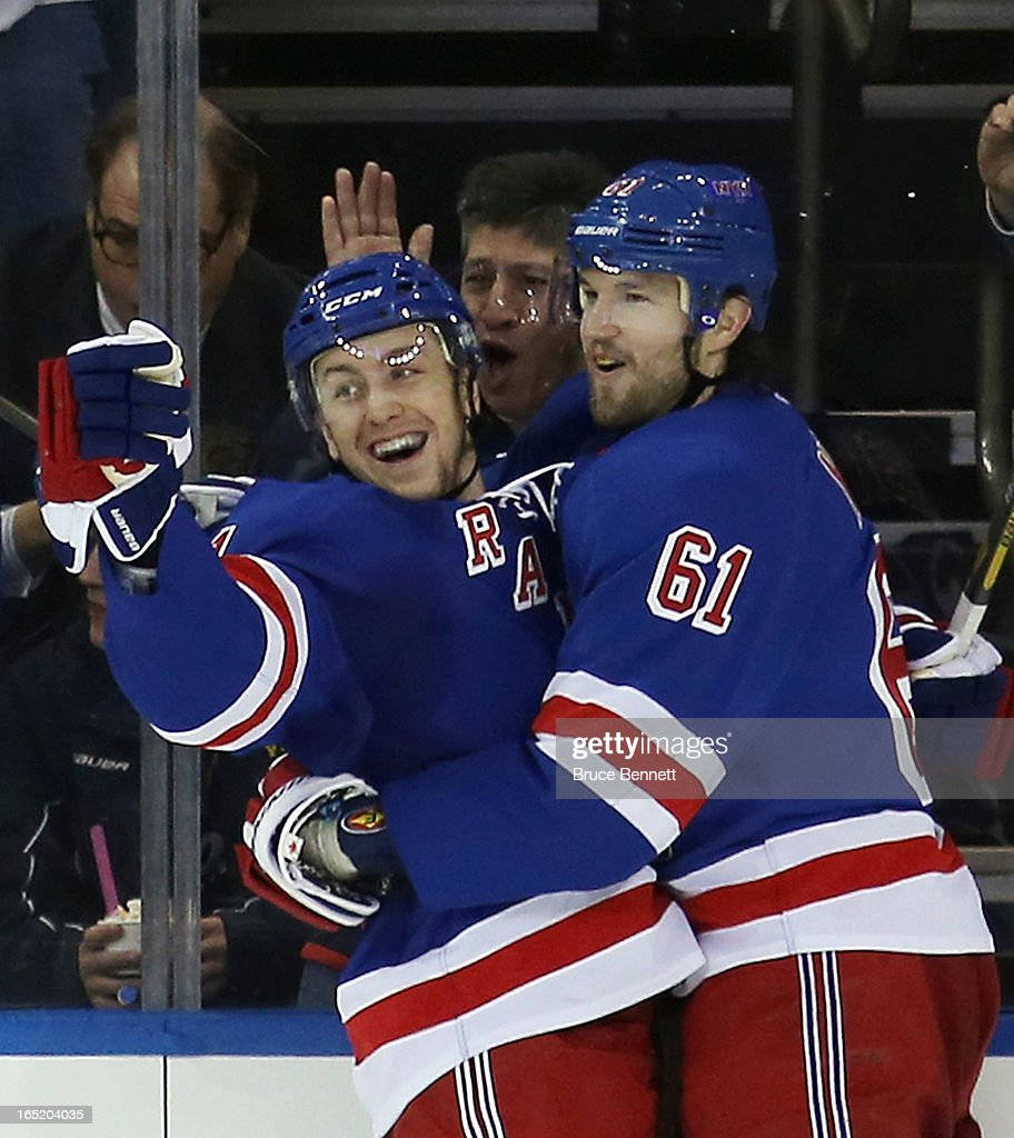 <a gi-track='captionPersonalityLinkClicked' href=/galleries/search?phrase=Derek+Stepan&family=editorial&specificpeople=4687181 ng-click='$event.stopPropagation()'>Derek Stepan</a> #21 (L) of the New York Rangers scores his second goal of the game at 5:46 of the third period against the Winnipeg Jets and is joined by <a gi-track='captionPersonalityLinkClicked' href=/galleries/search?phrase=Rick+Nash&family=editorial&specificpeople=202196 ng-click='$event.stopPropagation()'>Rick Nash</a> #61 (R) at Madison Square Garden on April 1, 2013 in New York City. The Rangers defeated the Jets 4-2.