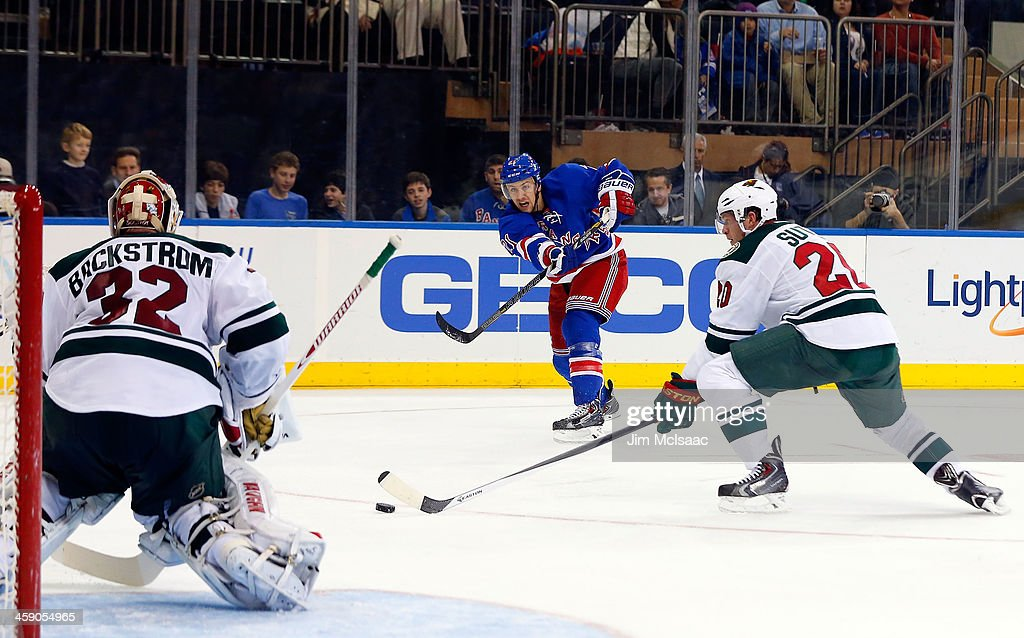 <a gi-track='captionPersonalityLinkClicked' href=/galleries/search?phrase=Derek+Stepan&family=editorial&specificpeople=4687181 ng-click='$event.stopPropagation()'>Derek Stepan</a> #21 of the New York Rangers shoots the puck in the second period against Niklas Backstrom #32 and <a gi-track='captionPersonalityLinkClicked' href=/galleries/search?phrase=Ryan+Suter&family=editorial&specificpeople=583306 ng-click='$event.stopPropagation()'>Ryan Suter</a> #20 of the Minnesota Wild at Madison Square Garden on December 22, 2013 in New York City.