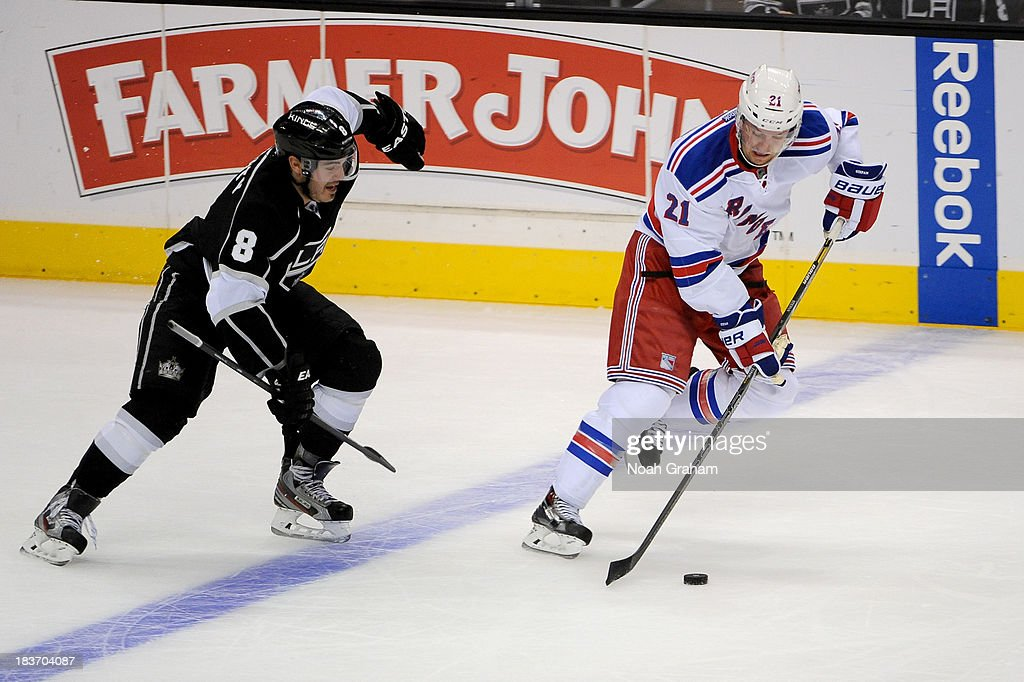 <a gi-track='captionPersonalityLinkClicked' href=/galleries/search?phrase=Derek+Stepan&family=editorial&specificpeople=4687181 ng-click='$event.stopPropagation()'>Derek Stepan</a> #21 of the New York Rangers skates with the puck against <a gi-track='captionPersonalityLinkClicked' href=/galleries/search?phrase=Drew+Doughty&family=editorial&specificpeople=2085761 ng-click='$event.stopPropagation()'>Drew Doughty</a> #8 of the Los Angeles Kings at Staples Center on October 7, 2013 in Los Angeles, California.