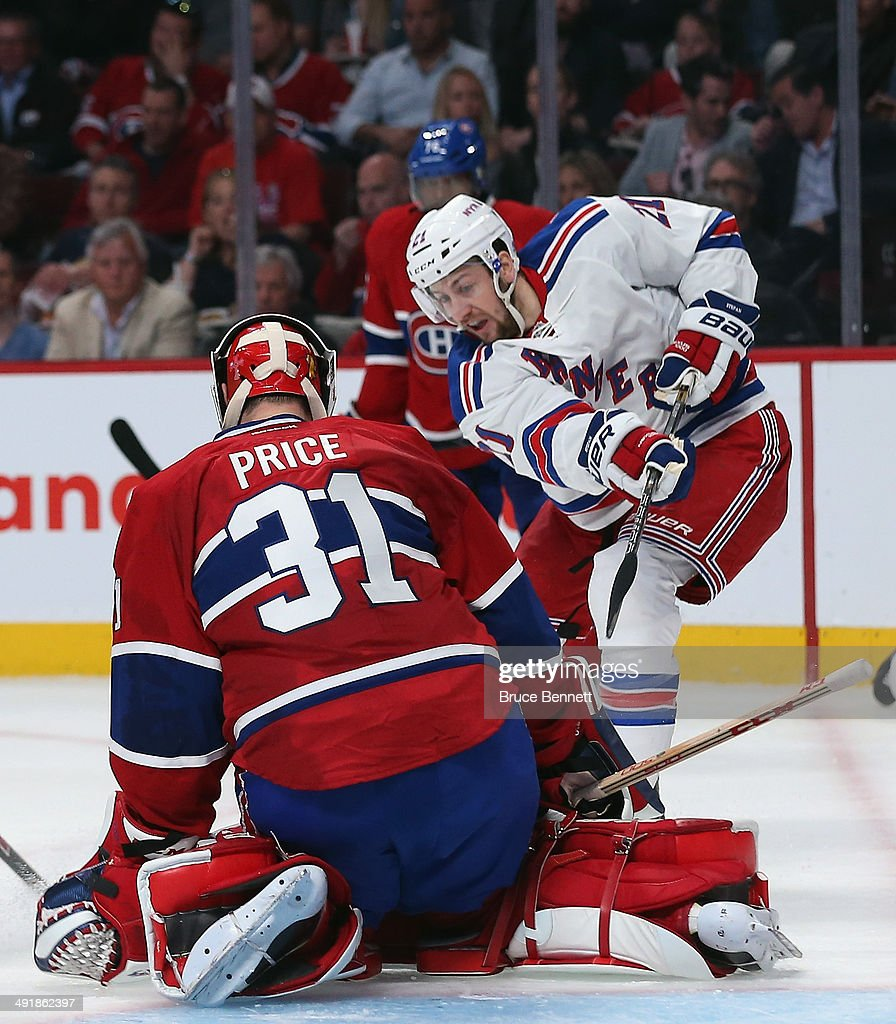 Derek Stepan #21 of the New York Rangers takes the shot against Carey Price #31 of the Montreal Canadiens in Game One of the Eastern Conference Final during the 2014 Stanley Cup Playoffs at the Bell Centre on May 17, 2014 in Montreal, Canada. The Rangers defeated the Canadiens 7-2.