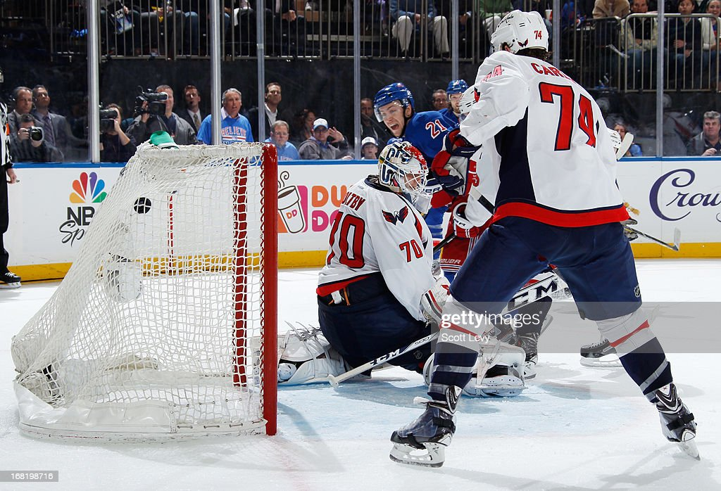 <a gi-track='captionPersonalityLinkClicked' href=/galleries/search?phrase=Derek+Stepan&family=editorial&specificpeople=4687181 ng-click='$event.stopPropagation()'>Derek Stepan</a> #21 of the New York Rangers watches as the puck enters the net in the third period against the Washington Capitals in Game Three of the Eastern Conference Quarterfinals during the 2013 NHL Stanley Cup Playoffs at Madison Square Garden on May 6, 2013 in New York City.