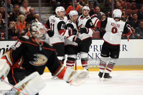 Derek Stepan Oliver EkmanLarsson and Clayton Keller congratulate Max Domi of the Arizona Coyotes after his goal as John Gibson of the Anaheim Ducks...