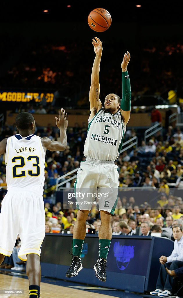 Derek Thompson #5 of the Eastern Michigan Eagles shoots a second half jump shot over Caris LeVert #23 of the Michigan Wolverines at Crisler Center on December 20, 2012 in Ann Arbor, Michigan.