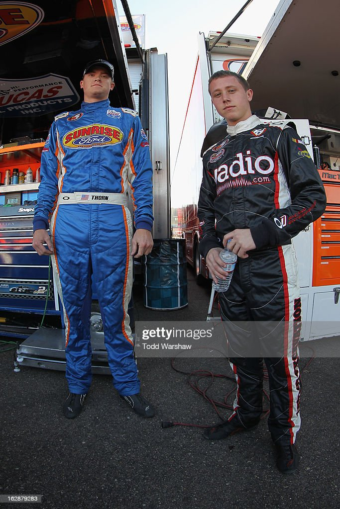 Derek Thorn, driver of the #6 Sunrise Ford/Lucas Oil/Eibach Ford, talks with Dylan Lupton, driver of the #9 Lupton Excavating/Sunrise Ford, during NASCAR K&N Pro Series West practice for the Talking Stick Resort 60 at Phoenix International Raceway on February 28, 2013 in Avondale, Arizona.