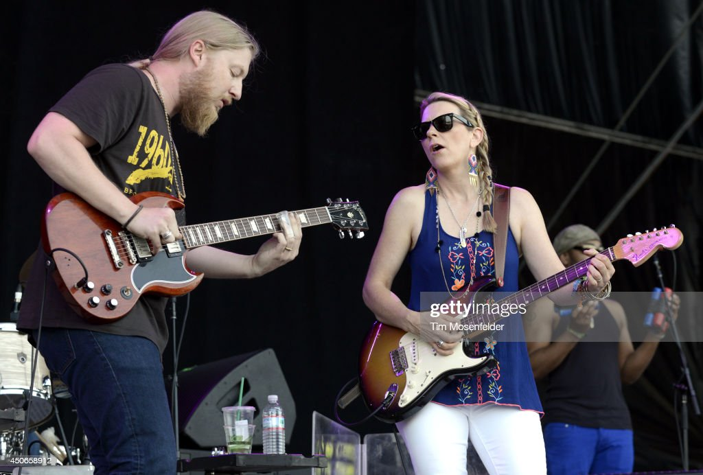 Derek Trucks (L) and Susan Tedechi of Tedeschi Trucks Band perform during the 2014 Bonnaroo Music & Arts Festival on June 14, 2014 in Manchester, Tennessee.