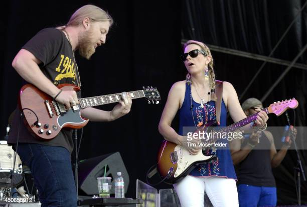 Derek Trucks and Susan Tedechi of Tedeschi Trucks Band perform during the 2014 Bonnaroo Music Arts Festival on June 14 2014 in Manchester Tennessee