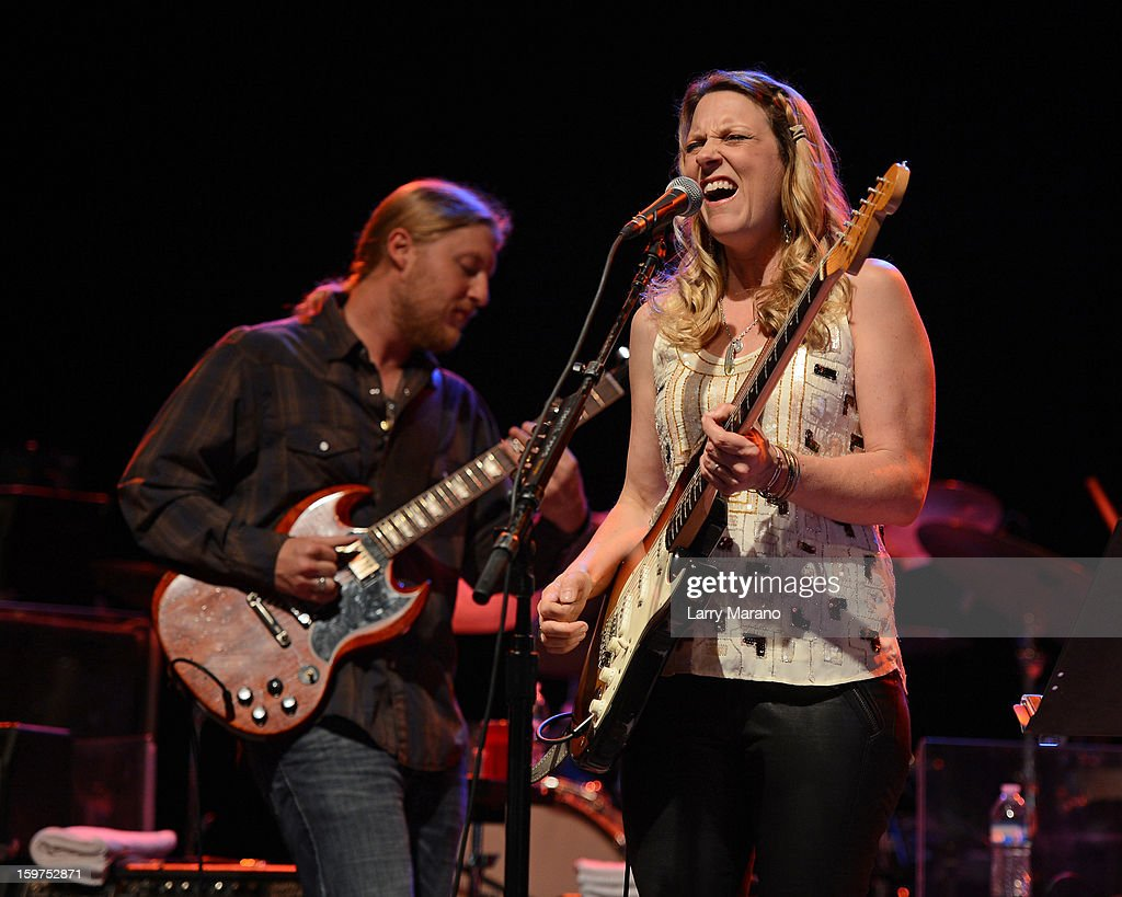 <a gi-track='captionPersonalityLinkClicked' href=/galleries/search?phrase=Derek+Trucks&family=editorial&specificpeople=2238705 ng-click='$event.stopPropagation()'>Derek Trucks</a> and <a gi-track='captionPersonalityLinkClicked' href=/galleries/search?phrase=Susan+Tedeschi&family=editorial&specificpeople=1563078 ng-click='$event.stopPropagation()'>Susan Tedeschi</a> perform during the Sunshine Blues Festival at Mizner Park Amphitheatre on January 19, 2013 in Boca Raton, Florida.