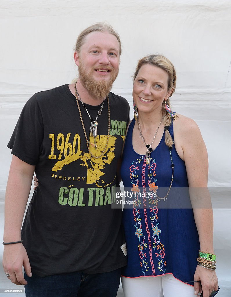 Derek Trucks and Susan Tedeschi pose backstage during the 2014 Bonnaroo Music & Arts Festival on June 14, 2014 in Manchester, Tennessee.