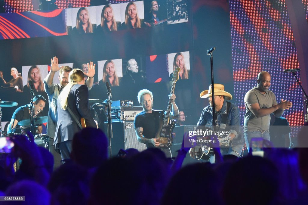 Derek Trucks, Charles Kelley of Lady Antebellum, Jason Aldean, and Darius Rucker perform onstage during the 2017 CMT Music Awards at the Music City Center on June 6, 2017 in Nashville, Tennessee.